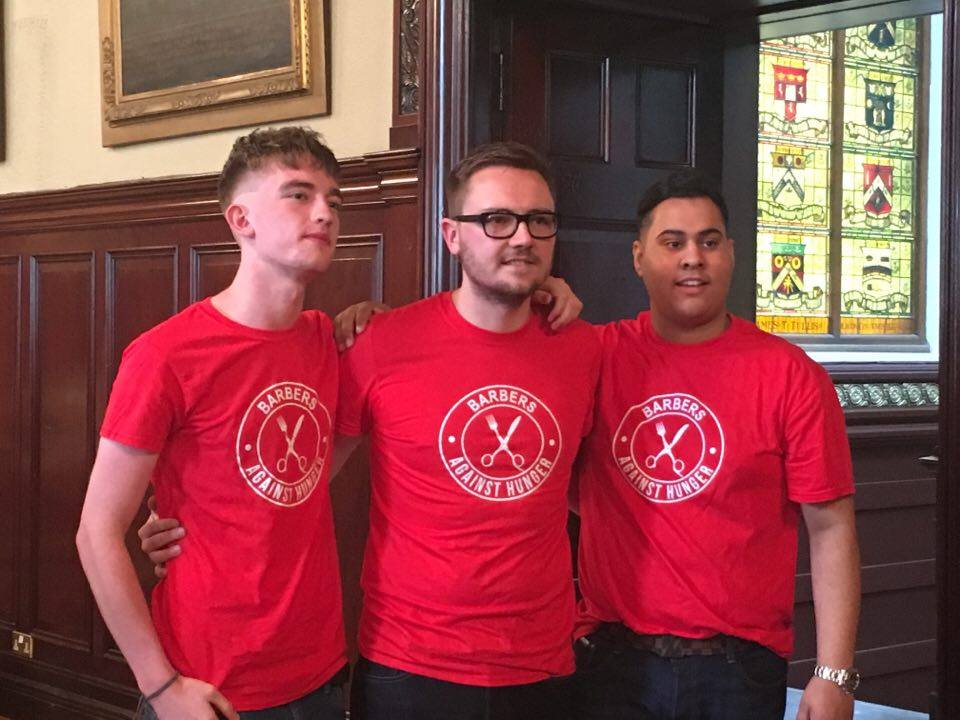 All the barbers had matching t-shirts for the event